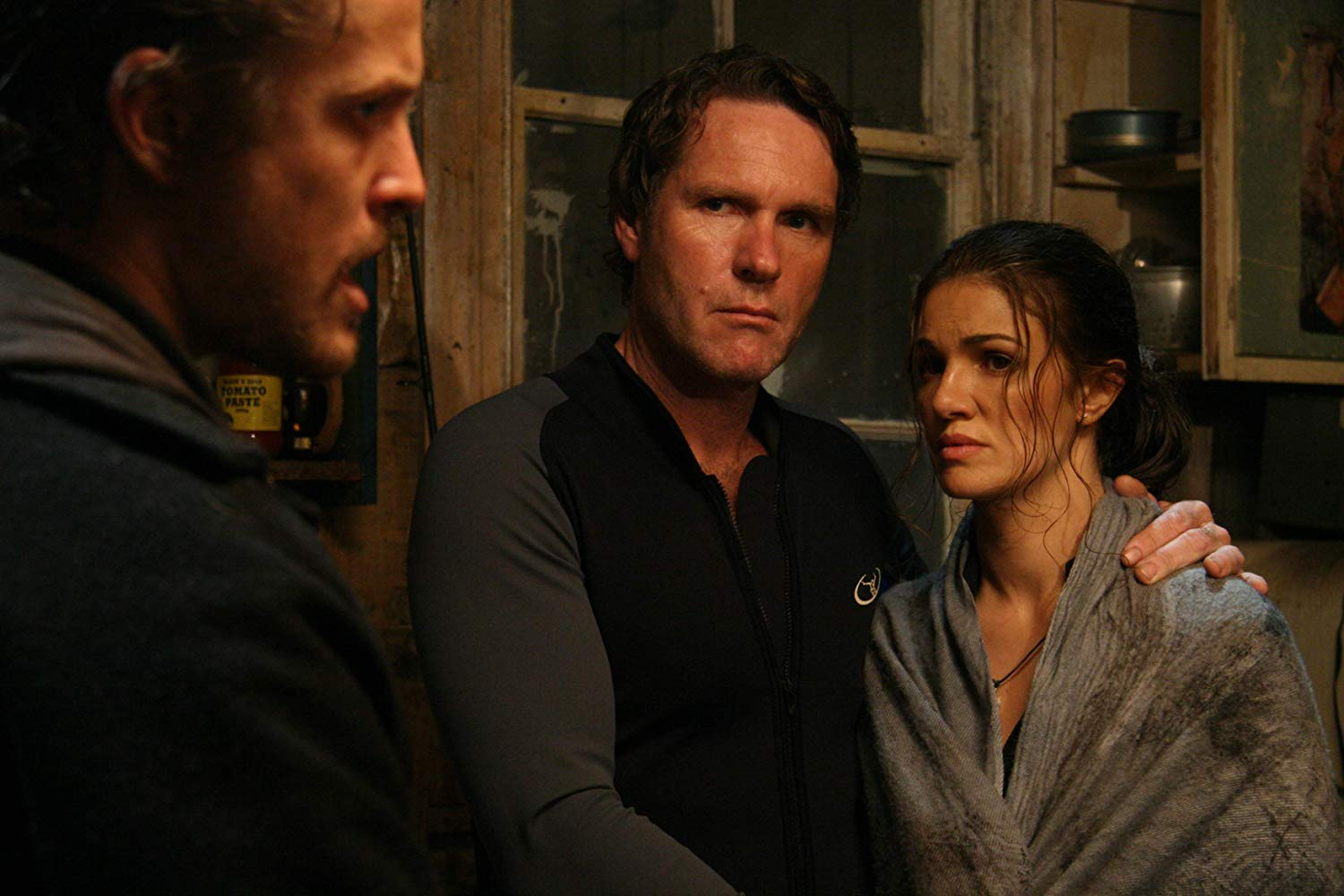 Robert Taylor and wife Nadia Fares fall afoul of backwoods hicks led by David Lyons in Storm Warning (2007)