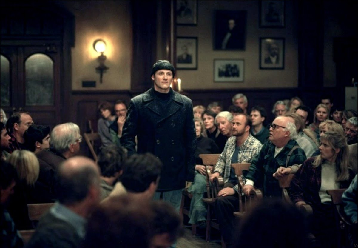 Linoge (Colm Feore) approaches the town hall meeting with his Faustian deal in Storm of the Century (1999)
