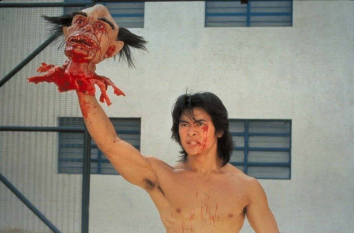 Ricky (Siu-Wong Fan) emerges with the warden's severed head in Story of Ricky (1991)