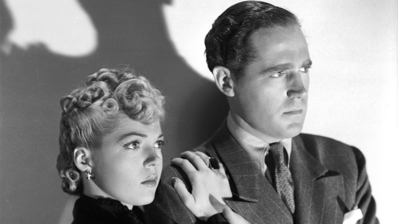 Private detective Jerry Church (Patrick Knowles) and neighbour Kit Logan (Anne Gwynne) in The Strange Case of Doctor Rx (1942)