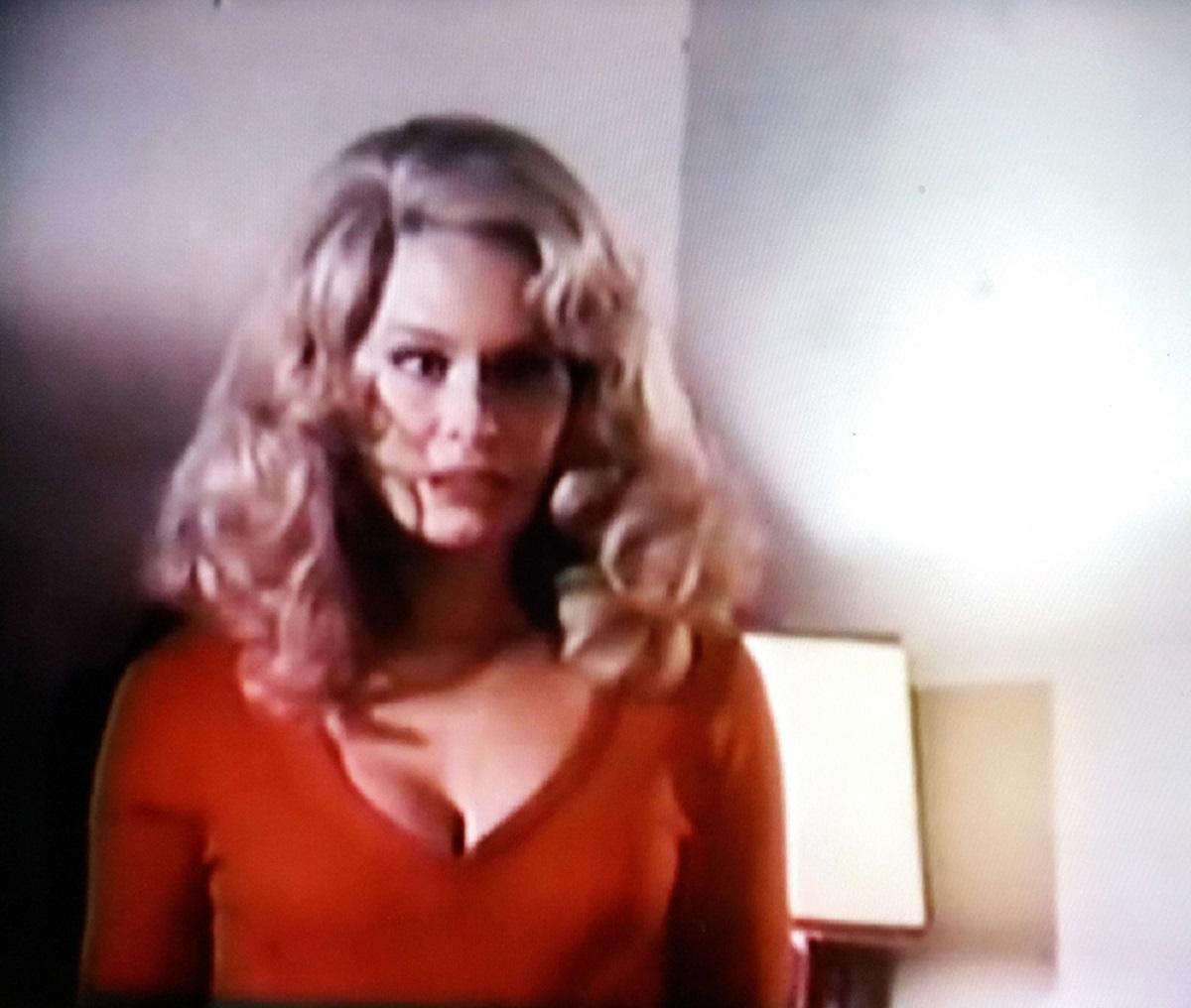 Karen Black as the possessed Miriam Oliver in red dress in The Strange Possession of Mrs Oliver (1977)