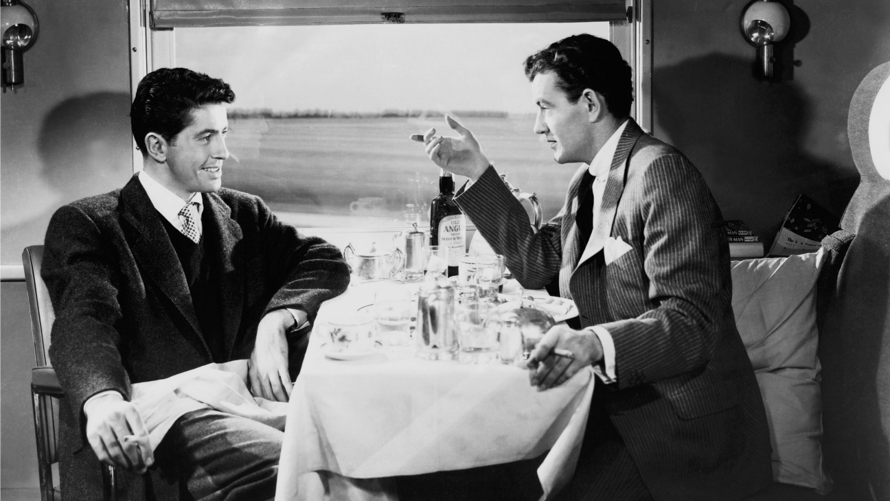 Strangers Farley Granger and Robert Walker make a murder pact after meeting in a train carriage in Strangers on a Train (1951)