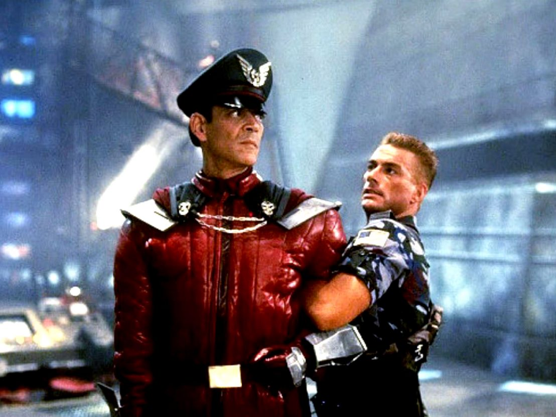 Jean Claude Van Damme, Raul Julia in Street Fighter (1994)
