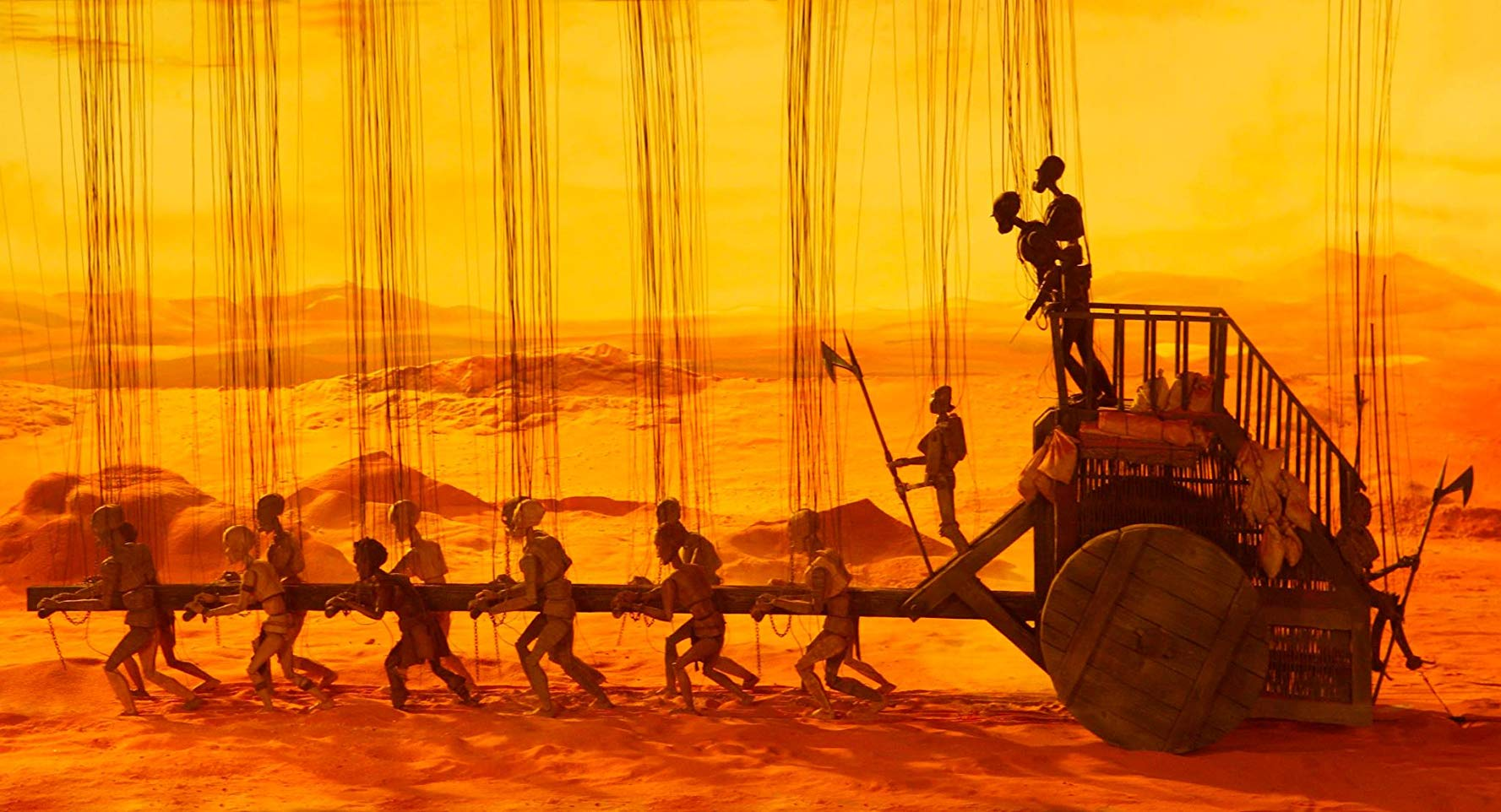 Wagon train pulled by slaves in Strings (2004)