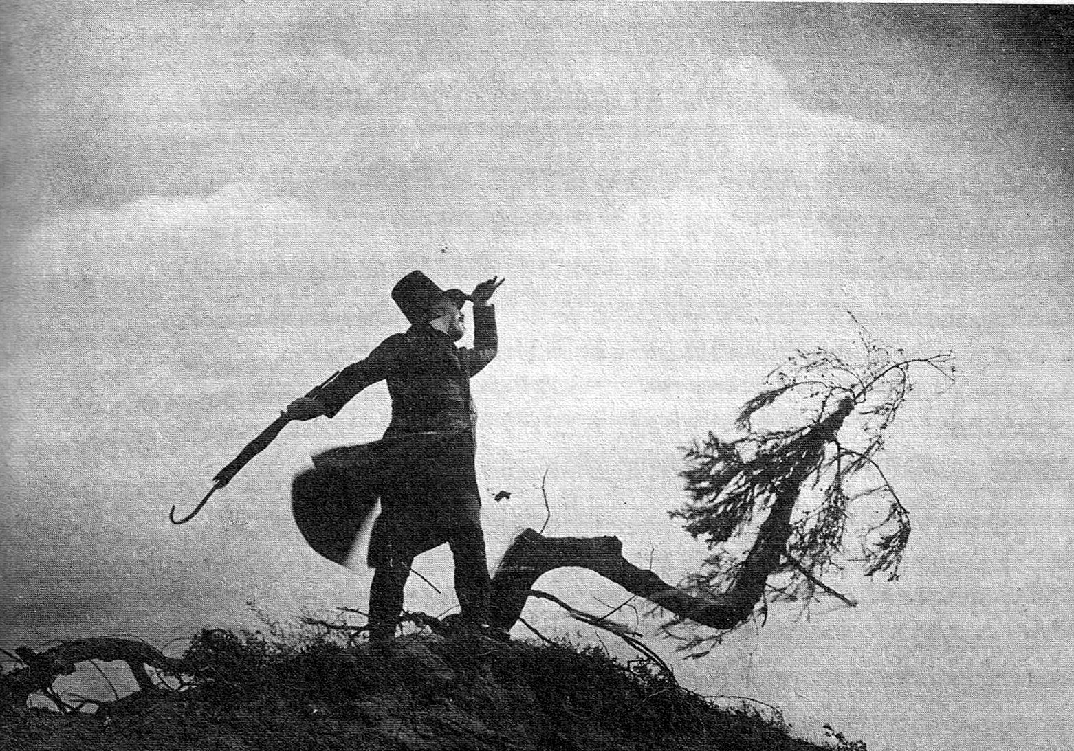 Scapinelli (Werner Krauss) stands on the hillside in The Student of Prague (1926)