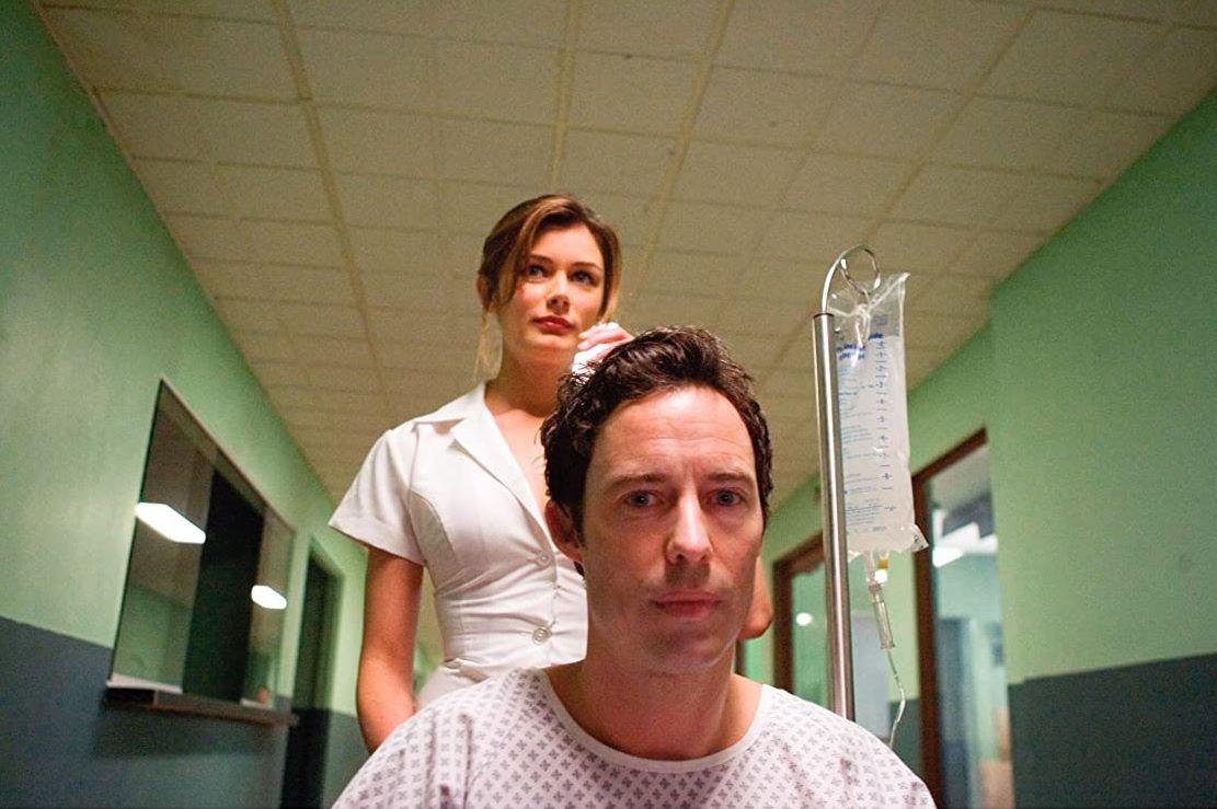 Tom Cavanagh is wheeled away by nurse Katherine Cunningham-Eves in Sublime (2007)
