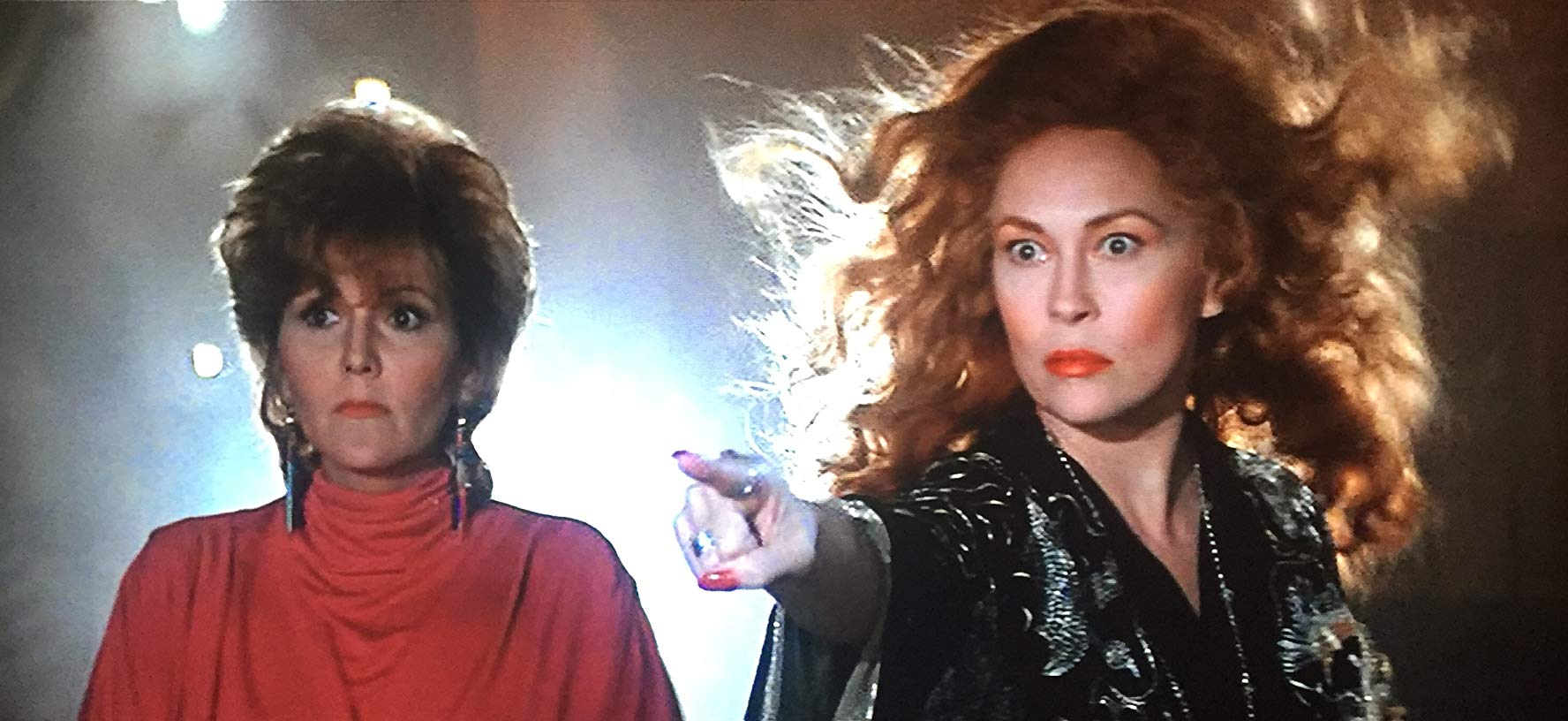 A madly overacting Faye Dunaway as the witch Selena (r) and her assistant Brenda Vaccaro (l) in Supergirl (1984)