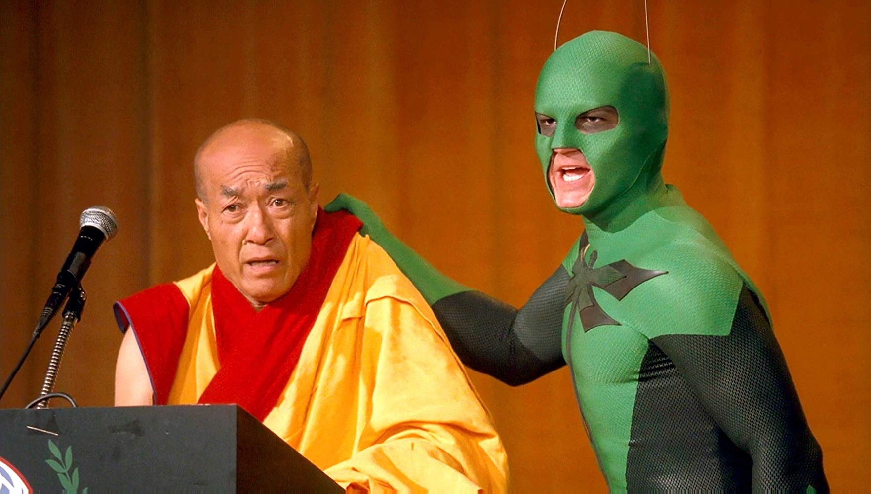 The Dragonfly (Drake Bell) apprehends the Dalai Lama in Superhero Movie (2008)
