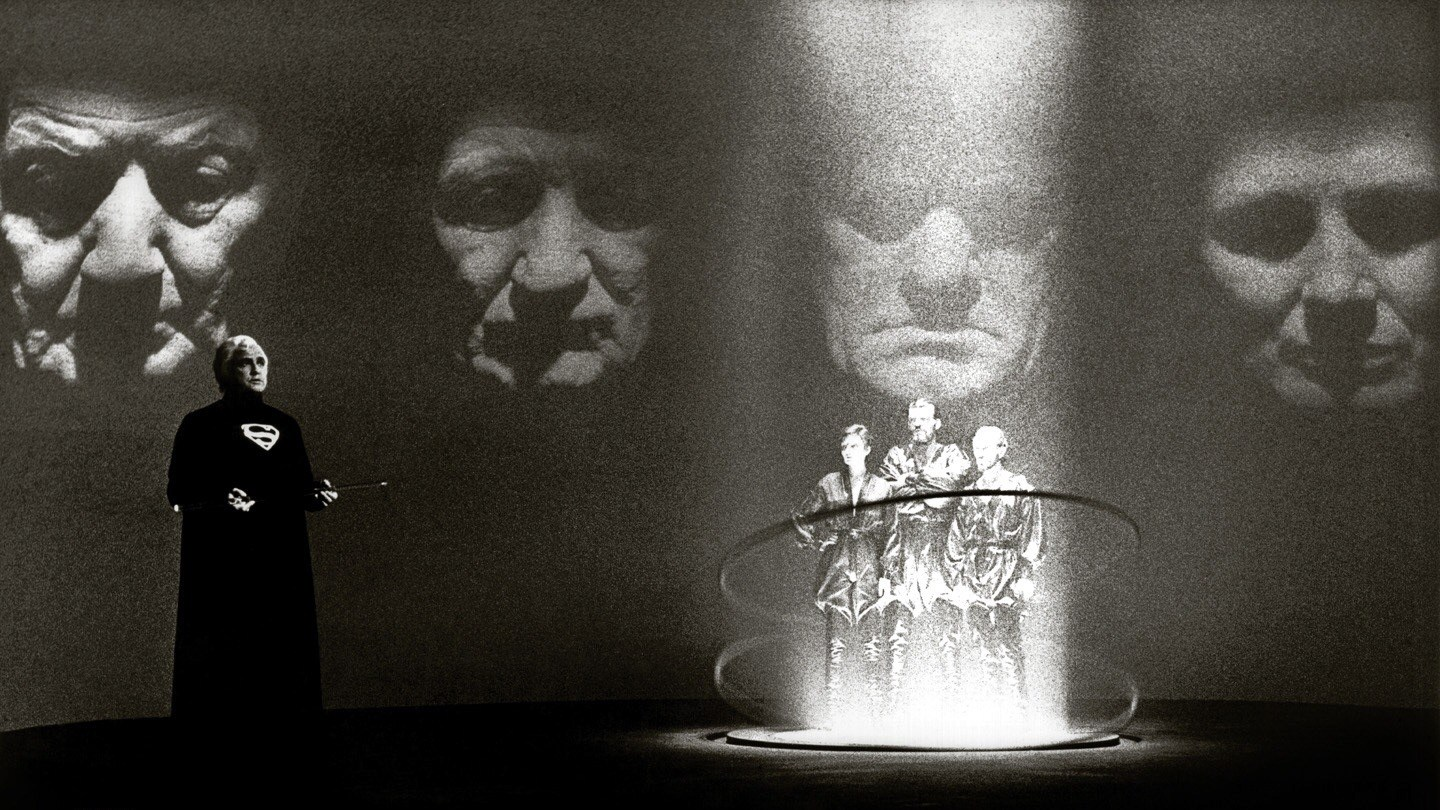 On Krypton, Jor-el (Marlon Brando) passes judgement on the Phantom Zone villains Ursa (Sarah Douglas), Non (Jack Halloran) and Zod (Terence Stamp) in Superman (1978)