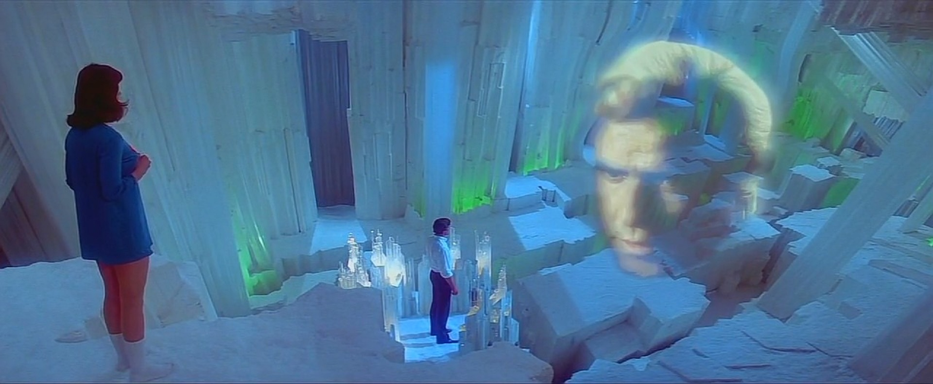 Lois Lane (Margot Kidder), Superman (Christopher Reeve) and the hologram Jor-el (Marlon Brando) at the Fortress of Solitude in Superman II The Richard Donner Cut (2006)