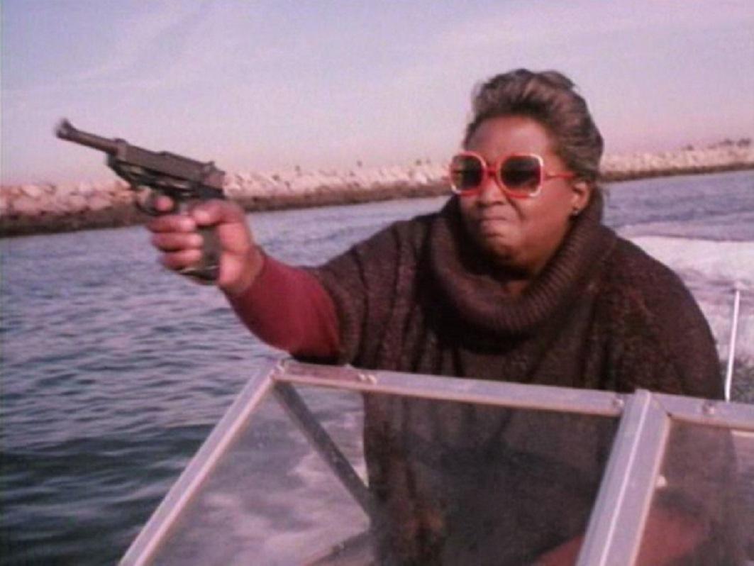 Gail Neely as Eleanor Washington seeking revenge in Surf Nazis Must Die (1987)