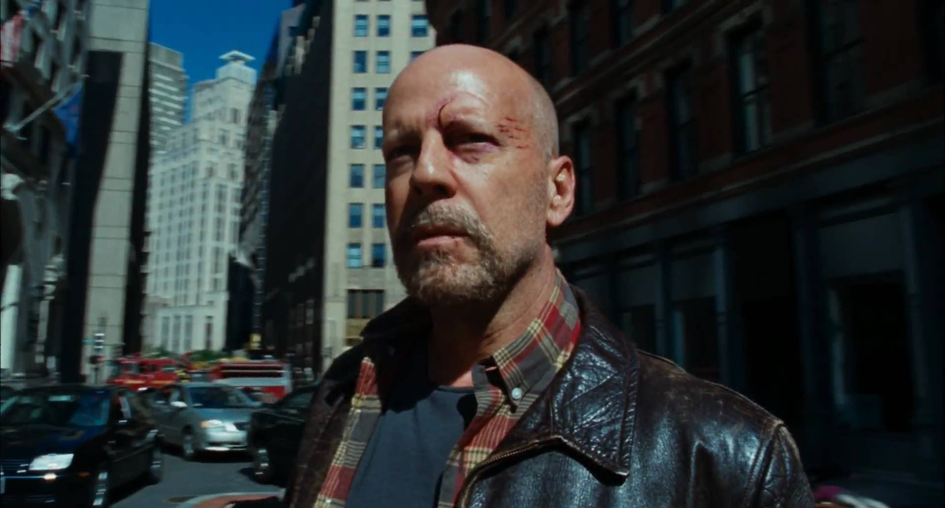 The middle-aging Bruce Willis emerges to deal with the real world in Surrogates (2009)