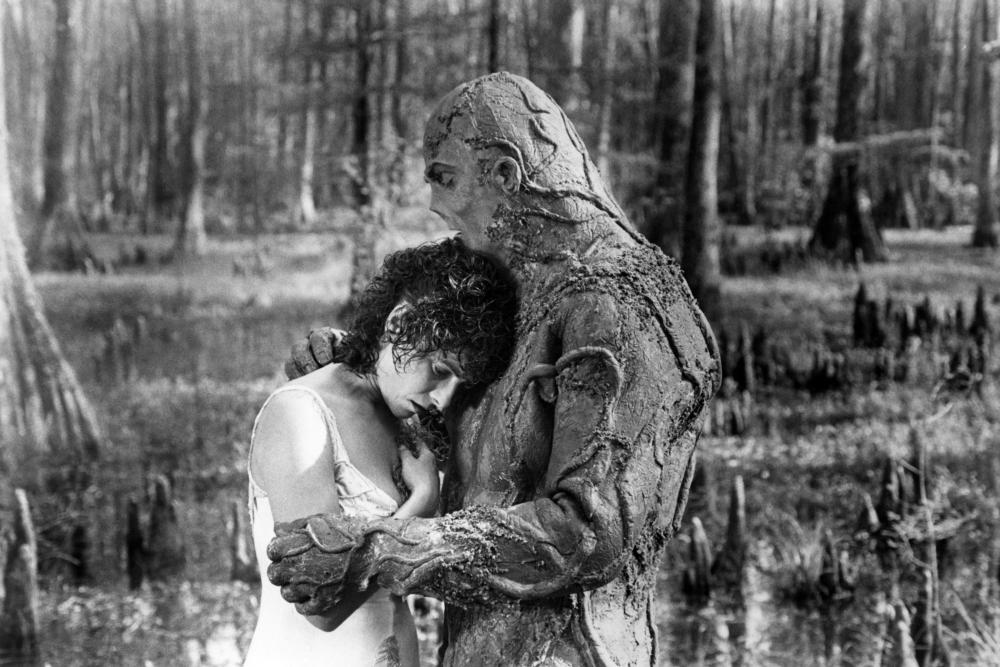 Alice Cable (Adrienne Barbeau) and Swamp Thing (Dick Durock) share a tender moment in Swamp Thing (1982)
