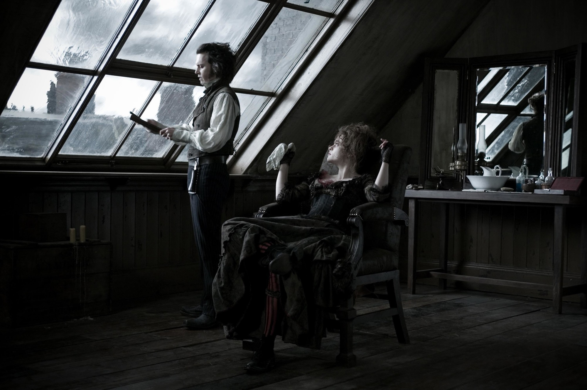 Sweeney Todd (Johnny Depp) and Mrs Lovett (Helena Bonham Carter) in Sweeney's barber shop in Sweeney Todd: The Demon Barber of Fleet Street (2007)