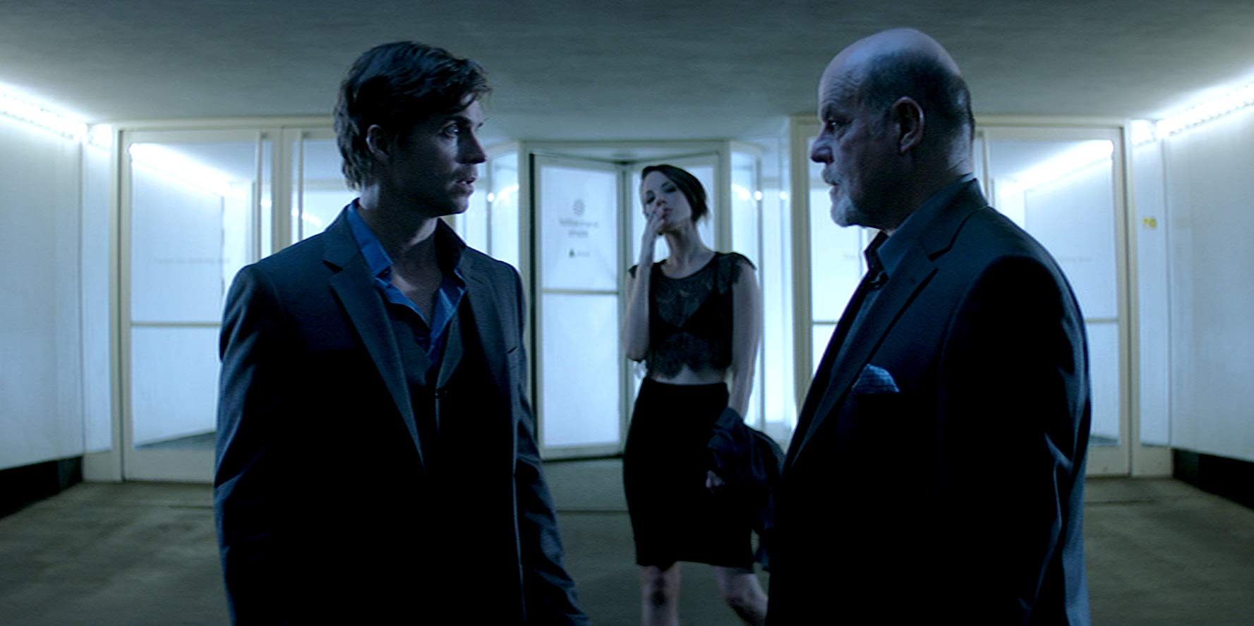 (l to r) Time traveller Chad McKnight, femme fatale Brianne Davis and venture capitalist bad guy Michael Ironside in Synchronicity (2015)