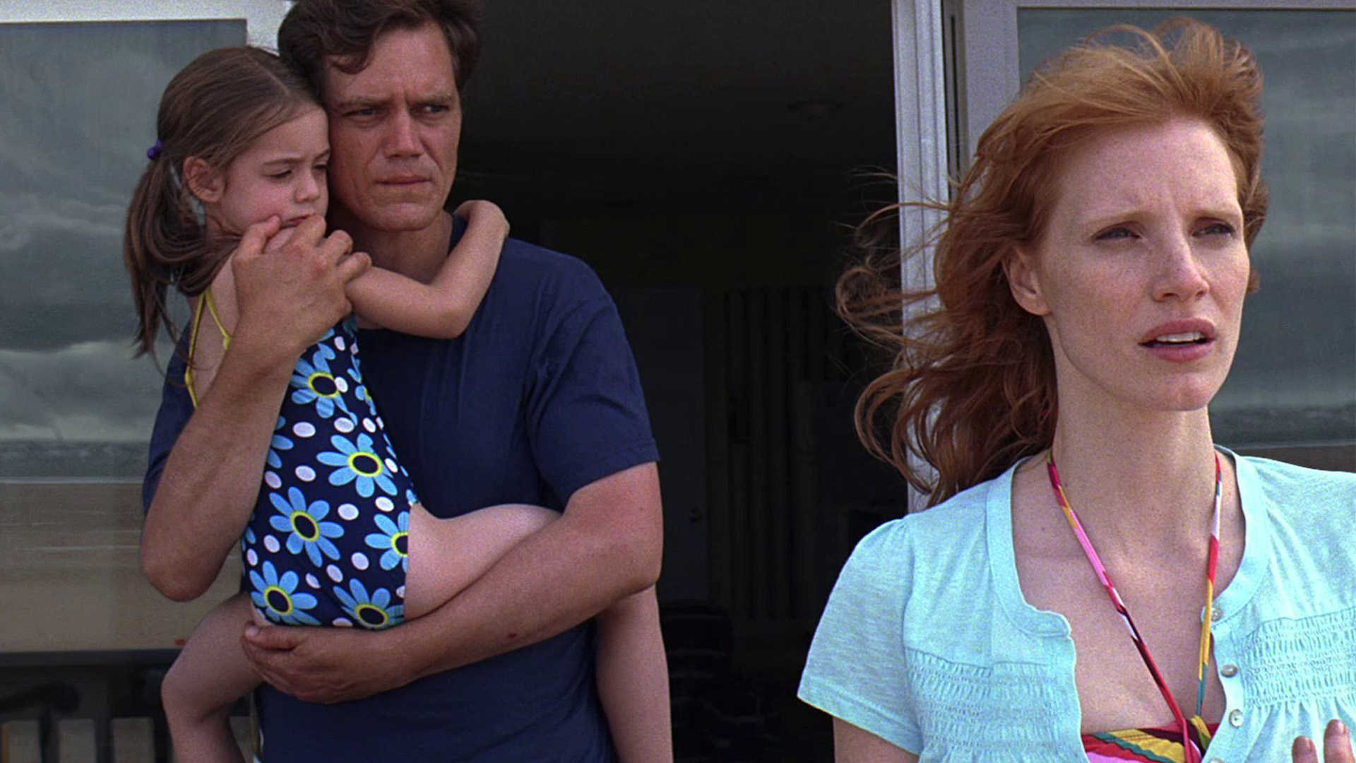 Michael Shannon holding daughter Tova Stewart with wife Jessica Chastain in Take Shelter (2011)