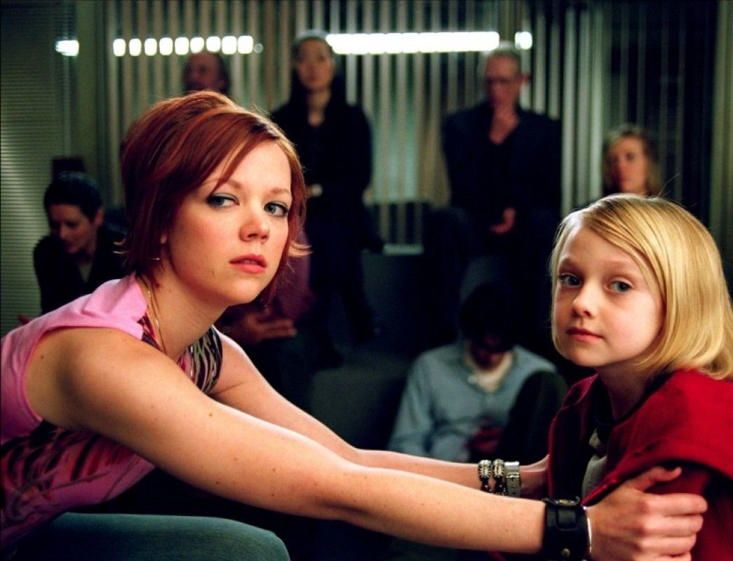 Emily Bergl, Dakota Fanning in Taken (2002)