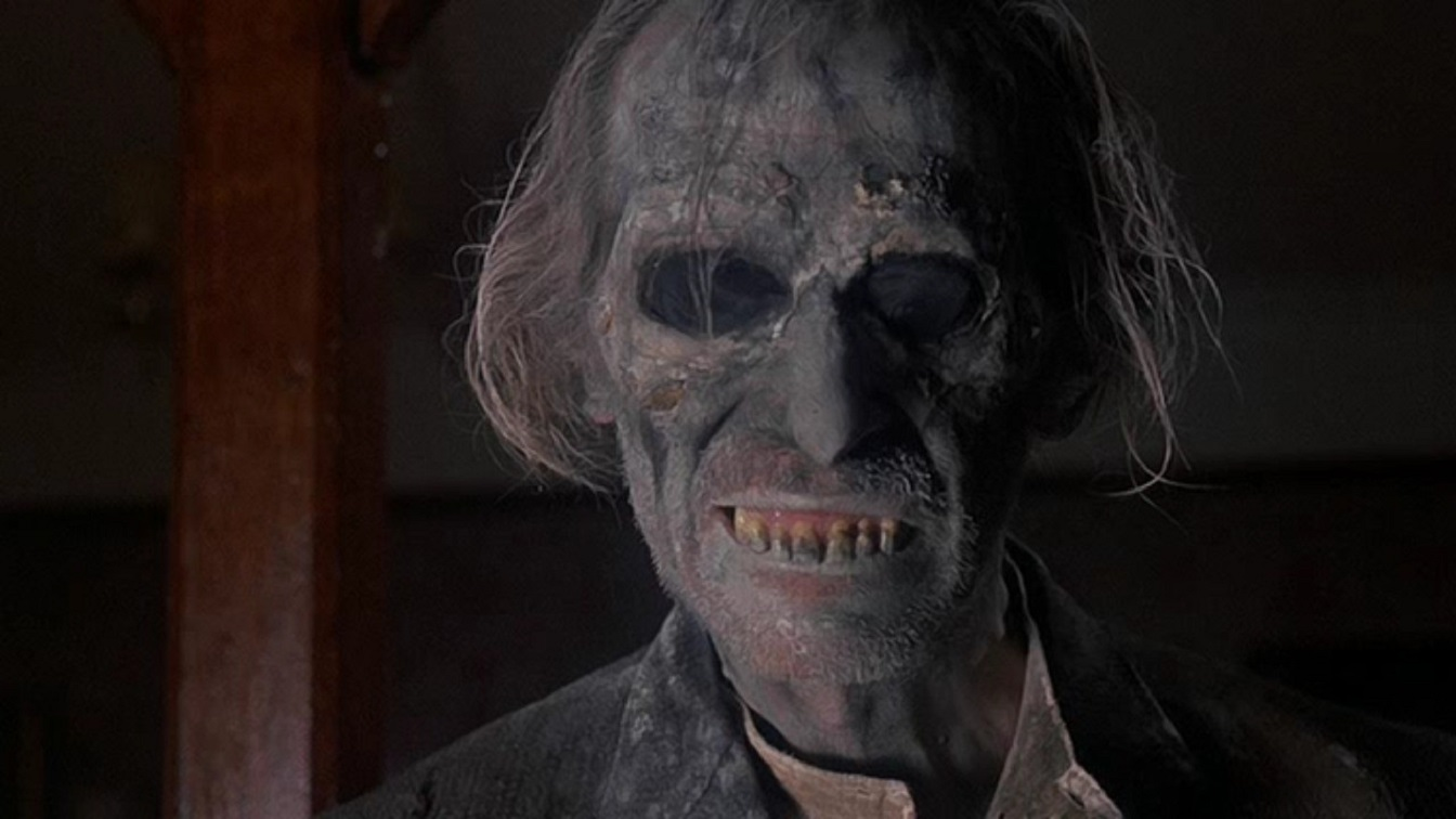 Grimsdyke (Peter Cushing) returns from the grave in the Poetic Justice episode of Tales from the Crypt (1972)