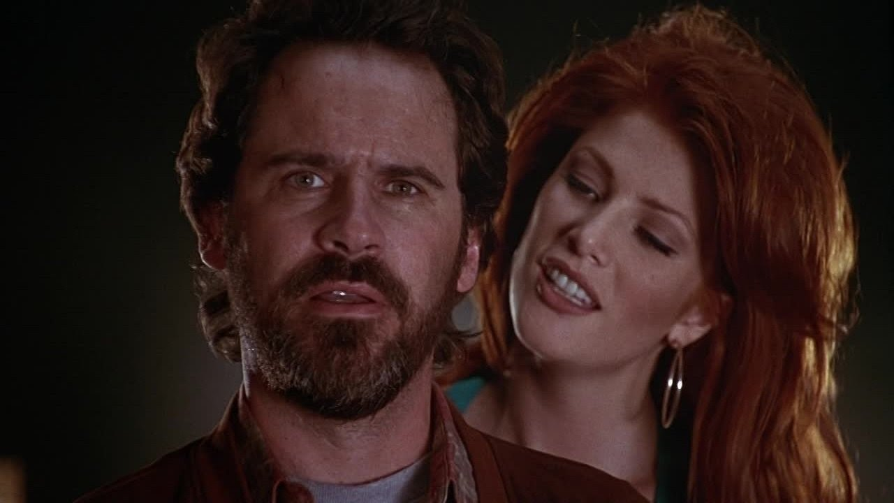 Private eye Dennis Miller and Angie Everhart as the vampire Lilith in Tales from the Crypt Presents Bordello of Blood (1996)
