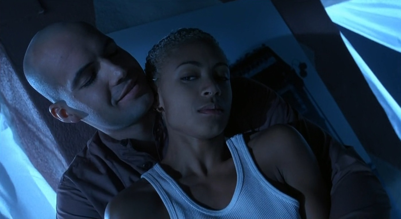 The Collector (Billy Zane) charms Jada Pinkett in Tales from the Crypt Presents Demon Knight (1995)