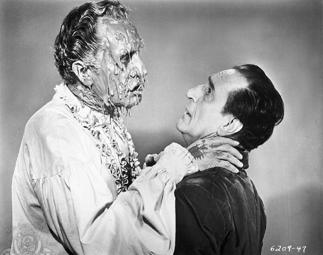 Valdemar (Vincent Price) undergoes gooey meltdown and attacks hypnotist Basil Rathbone after being kept alive in a hypnotic state following death in The Case of M. Valdemar episode from Tales of Terror (1962)