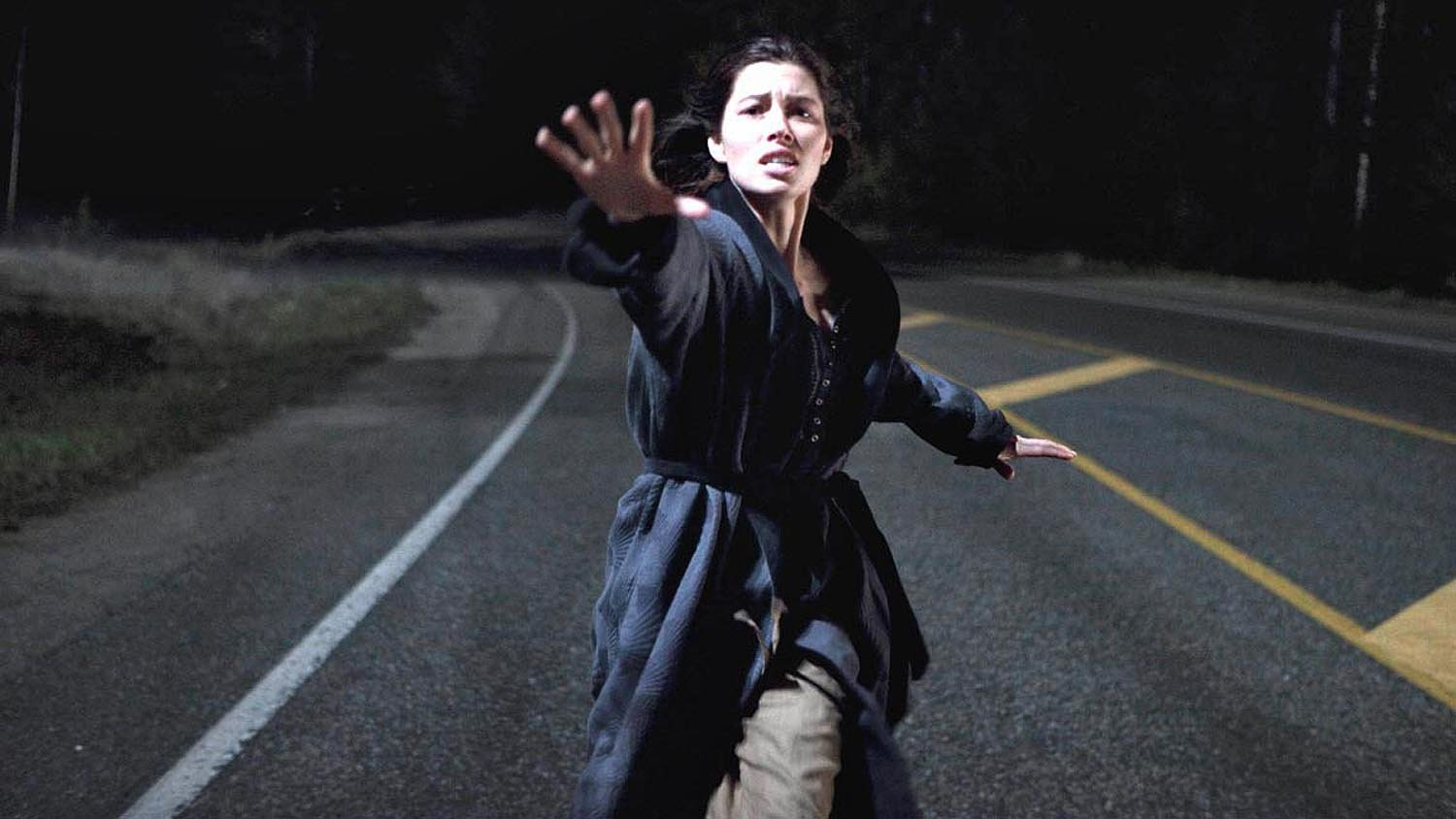 Jessica Biel runs in pursuit as The Tall Man's truck abducts her child in The Tall Man (2012)