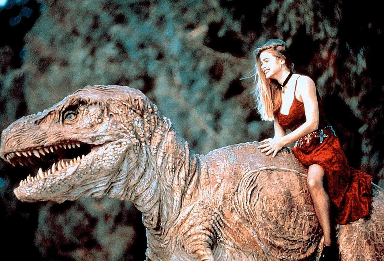 Denise Richards and dinosaur boyfriend in Tammy and the T-Rex (1994)
