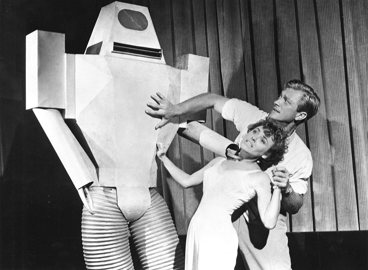 Kathleen Crowley and Richard Denning face the robot in Target Earth (1954)