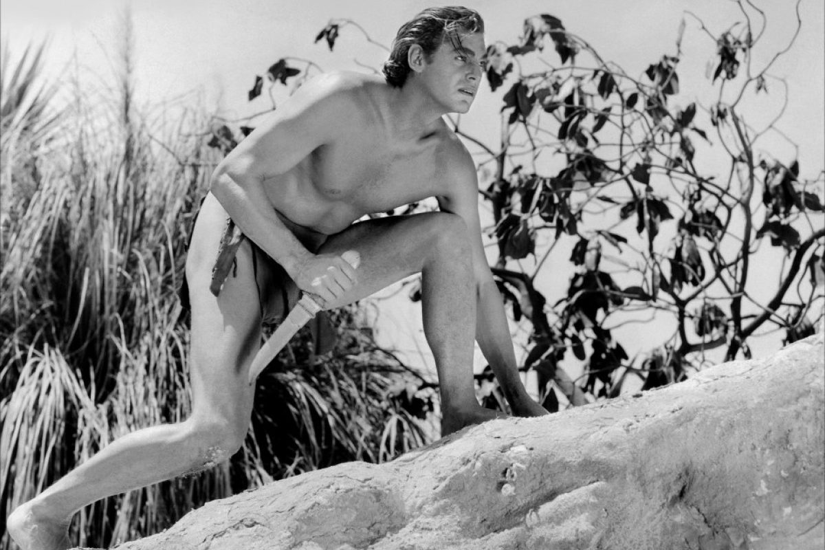 Five times Olympic gold medal winning swimming champion Johnny Weissmuller in action as Tarzan the Ape Man (1932)