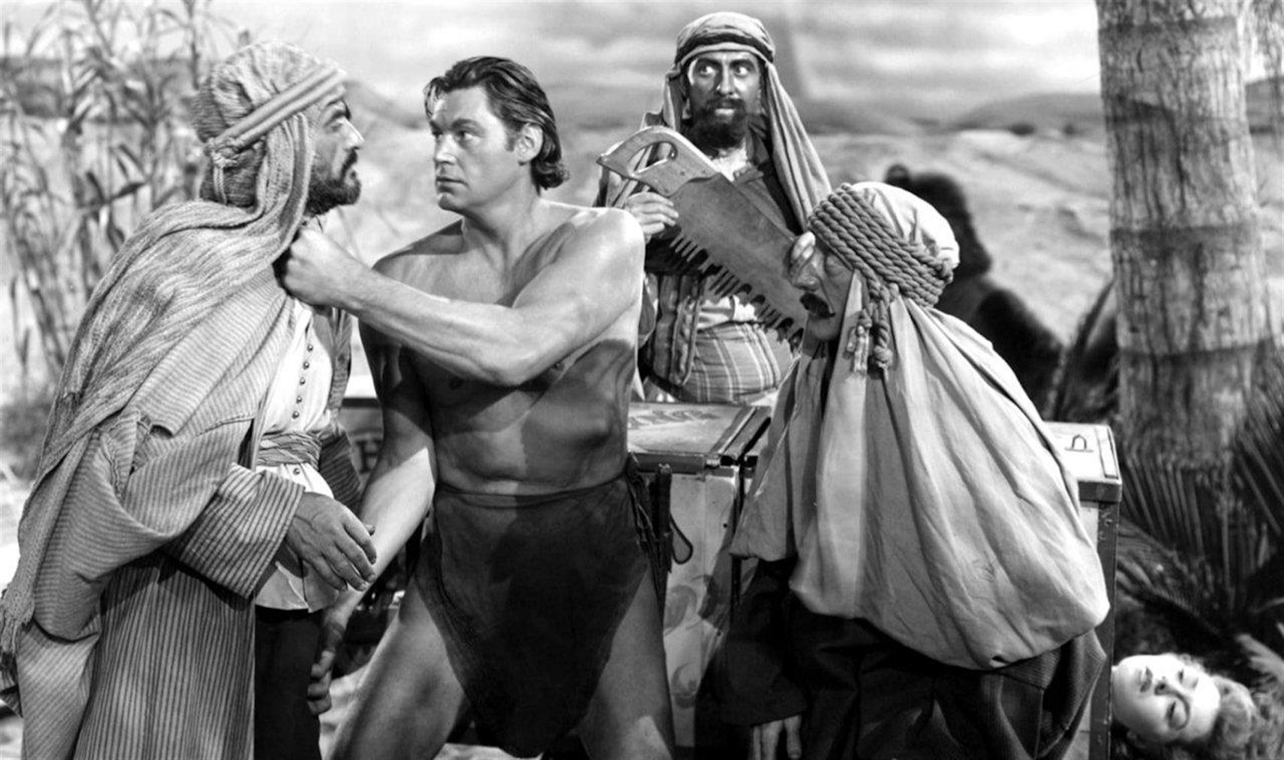 Tarzan (Johnny Weissmuller) takes on various locals to save an unconscious Nancy Kelly  in Tarzan's Desert Mystery (1943)