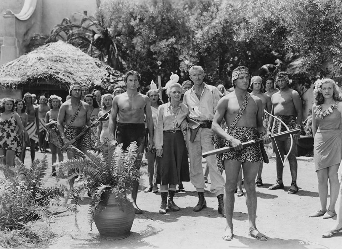 Lex Barker, Evelyn Ankers and Alan Napier enter a native village in Tarzan's Magic Fountain (1949)