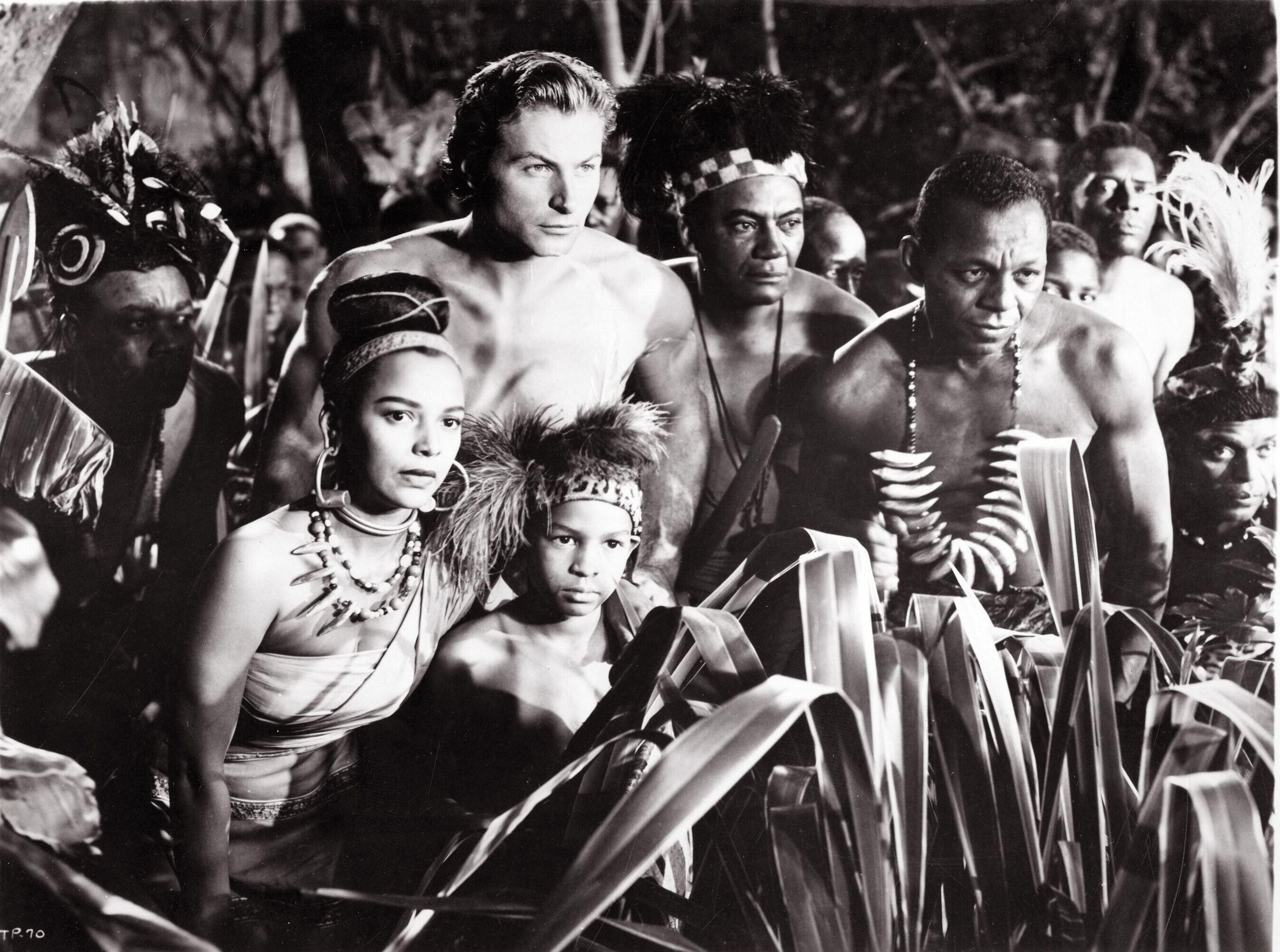 Tarzan (Lex Barker) come to the aid of the natives in Tarzan's Peril (1951)