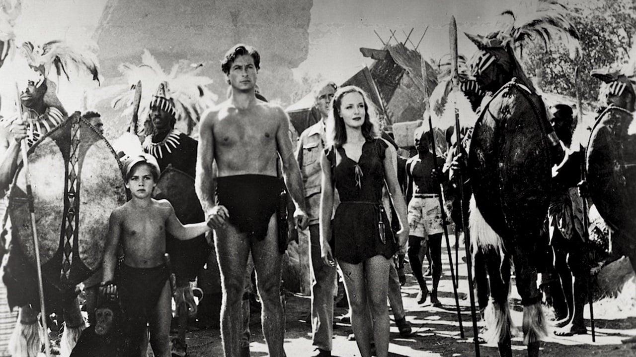 (l to r) The orphan Joey Martin (Tommy Carlton), Tarzan (Lex Barker) and Jane (Dorothy Hart) enter native territory in Tarzan's Savage Fury (1952)