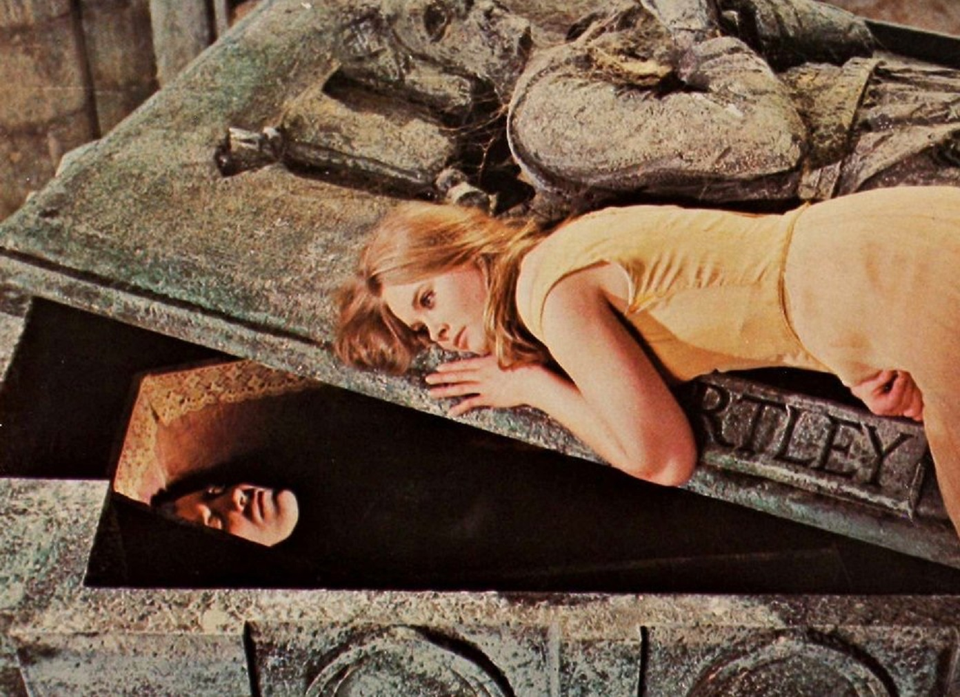 Linda Hayden curled up on Dracula (Christopher Lee)'s coffin in Taste the Blood of Dracula (1970)