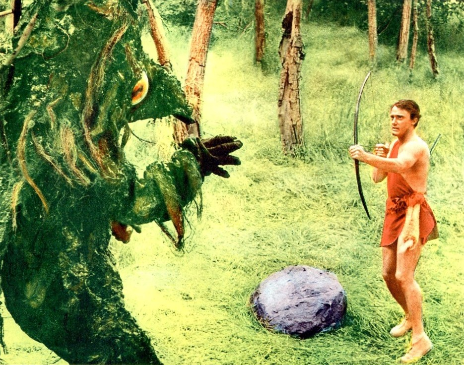 Teenage Caveman Robert Vaughn fights off a monster in Teenage Caveman (1958)