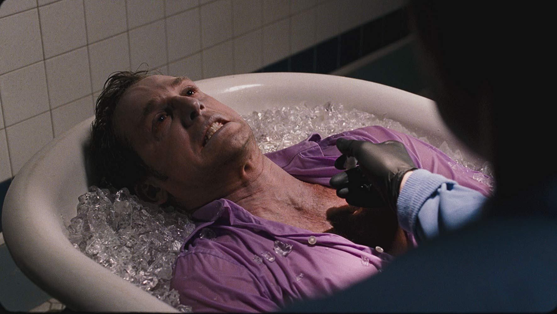 Josh Lucas being operated on in a bath of ice in Tell-Tale (2009)