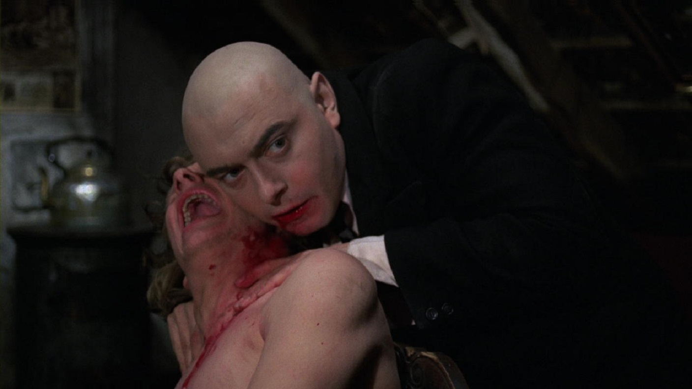 The famous image of a vampire-like Kurt Raab drinking from a victim's neck in The Tenderness of the Wolves (1973)