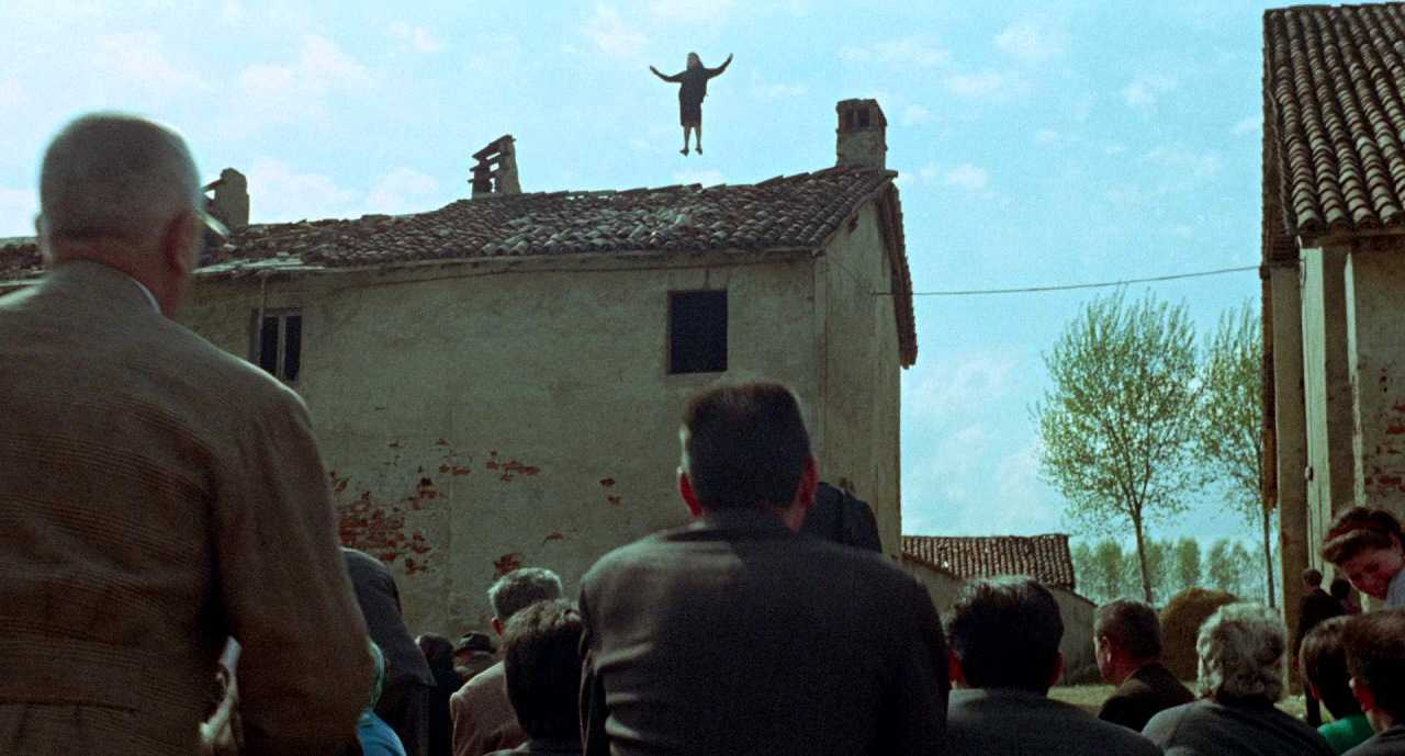 Maid Laura Betti is levitated into he air in an apparent miracle in Teorema (1968)