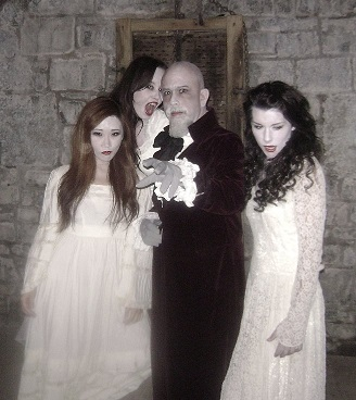 Director/writer Anthony D.P. Mann as Count Dracula (c) surrounded by vampire brides (Angela Faulkner, Vikki Jin and Noelle Piche) in Terror of Dracula (2012)