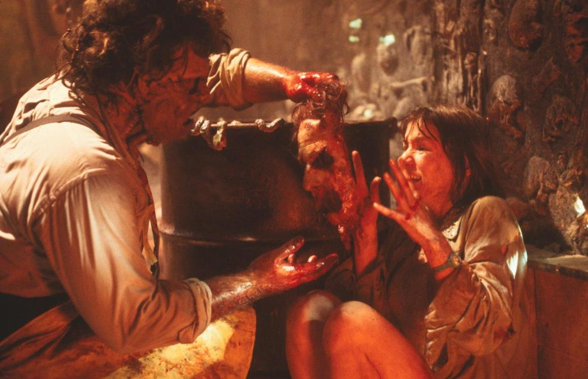 Leatherface (Bill Johnson) attempts to place a sliced-off human face on Caroline Williams in The Texas Chainsaw Massacre 2 (1986)