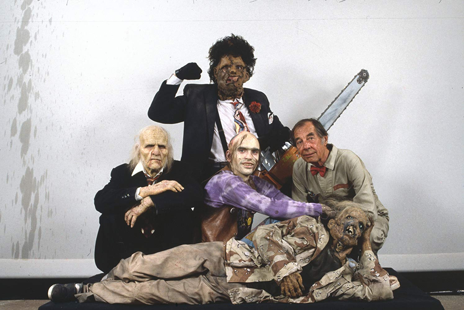 The Sawyer family - (l to r) Grandpa (Ken Evert), Leatherface (Bill Johnson), Chop-Top (Bill Moseley) and The Cook (Jim Siedow) in The Texas Chainsaw Massacre 2 (1986)