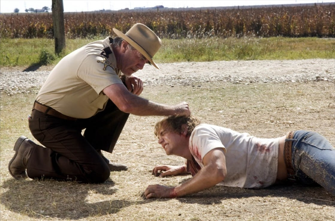 Sheriff Hoyt (R.Lee Ermey) brutalises Matt Bomer in The Texas Chainsaw Massacre: The Beginning (2006)