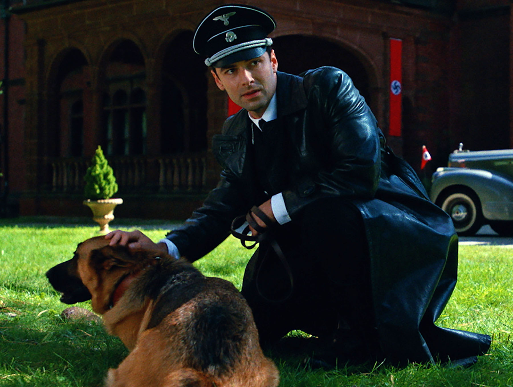 Aidan Turner as Calvin under cover as an SS officer in WWII in The Man Who Killed Hitler and Then The Bigfoot (2018)