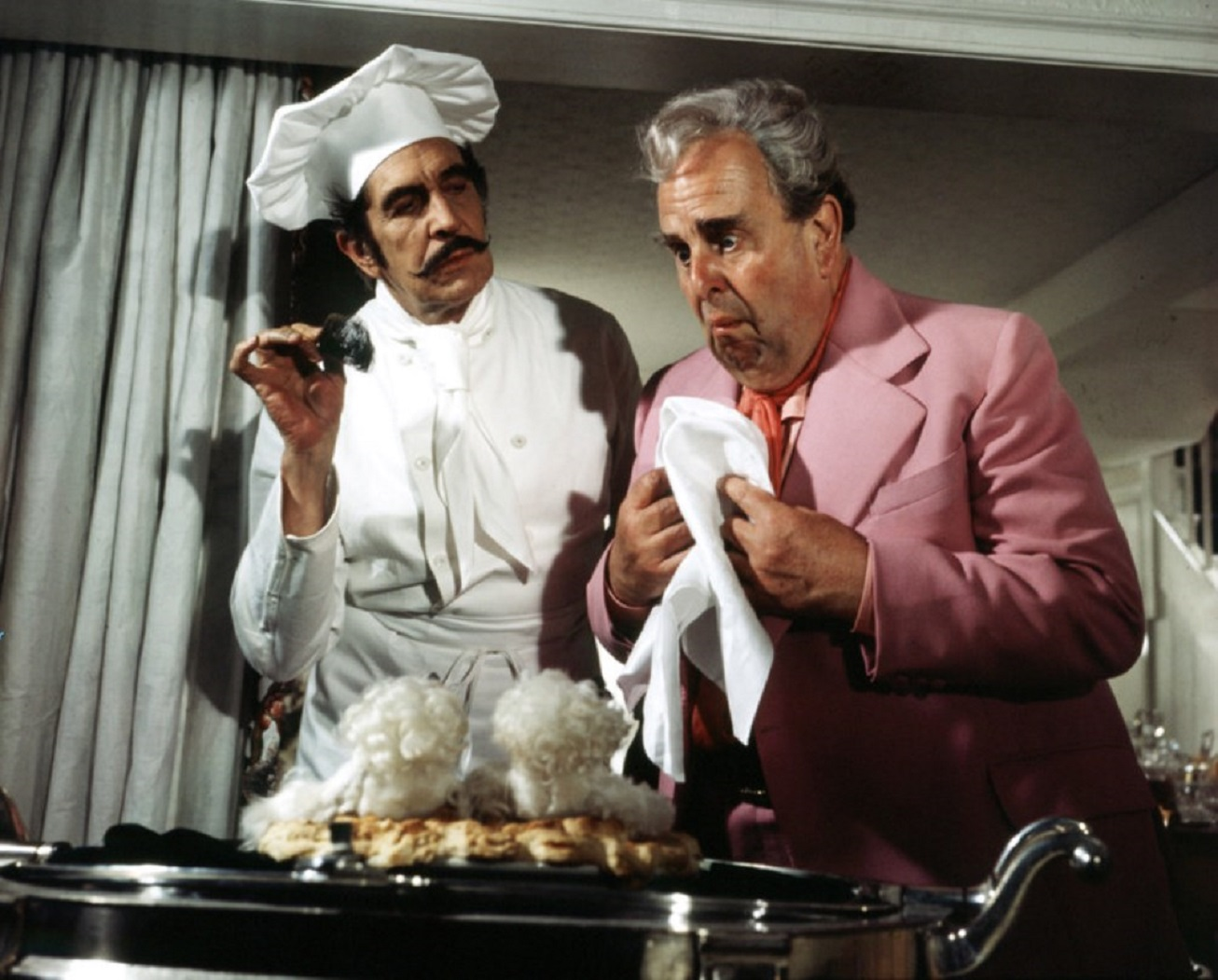 Mad Shakespearean actor Richard Lionheart (Vincent Price) serves Robert Morley his two beloved poodles baked in a pie in Theater of Blood (1973)