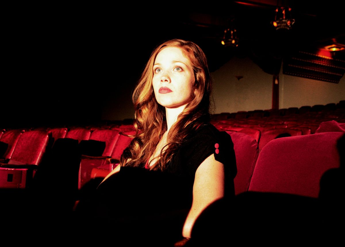 Virginia Newcomb sitting down to watch the show in the Theatre Guignol in The Theatre Bizarre (2011)