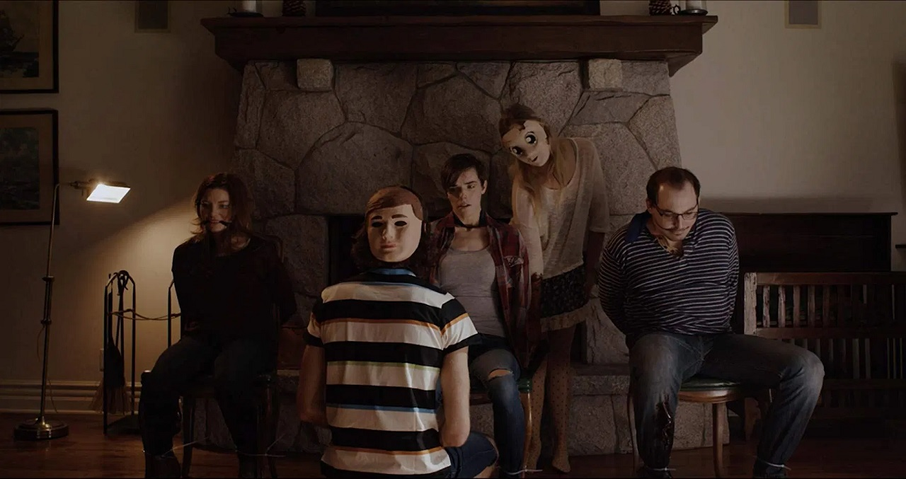 Amanda Kathleen Ward, Karli Hall, Schuyler Brumley and attackers Matthew Peschio and Alex Rinehart in They're Inside (2019)