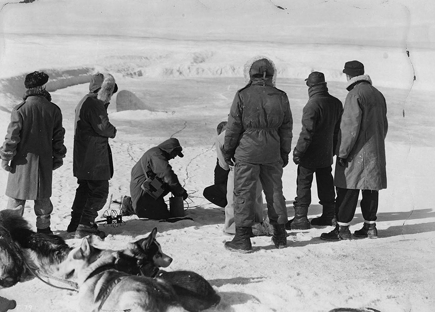 The men discover the saucer buried under the ice in The Thing from Another World (1951)