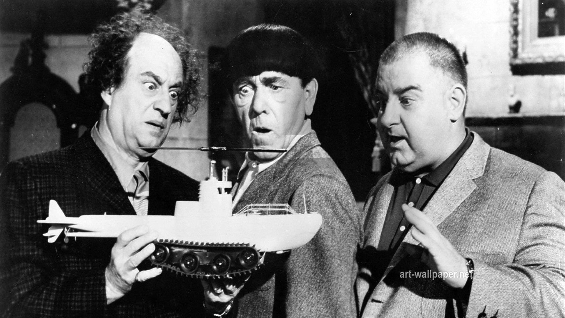 The Three Stooges - (l to r) Larry, Moe, Curly Joe holding the model of the tank/submarine/helicopter/rocketship in The Three Stooges in Orbit (1962)