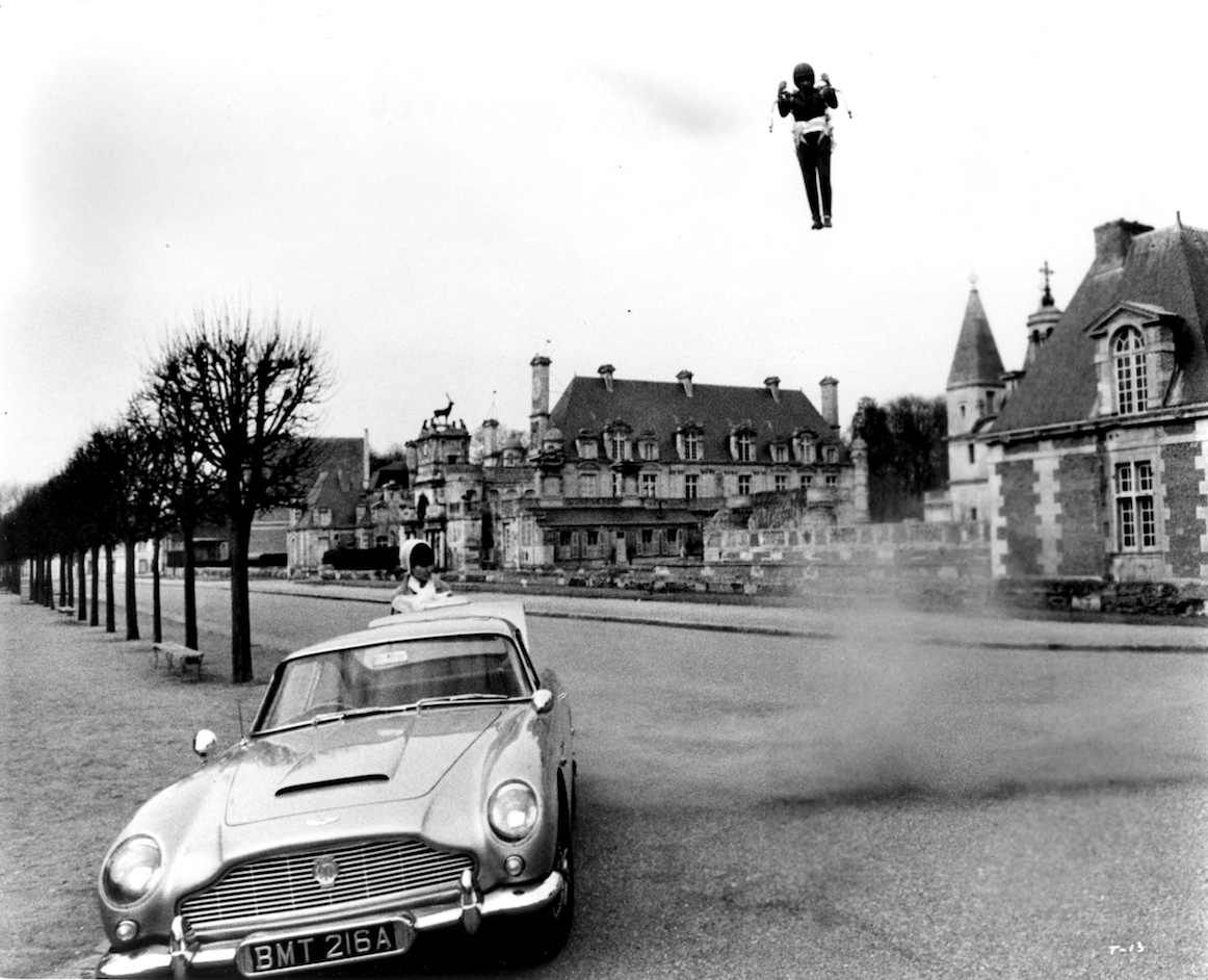 James Bond escapes from the chateau by rocket jetpck to the waiting Aston Martin in Thunderball (1965)