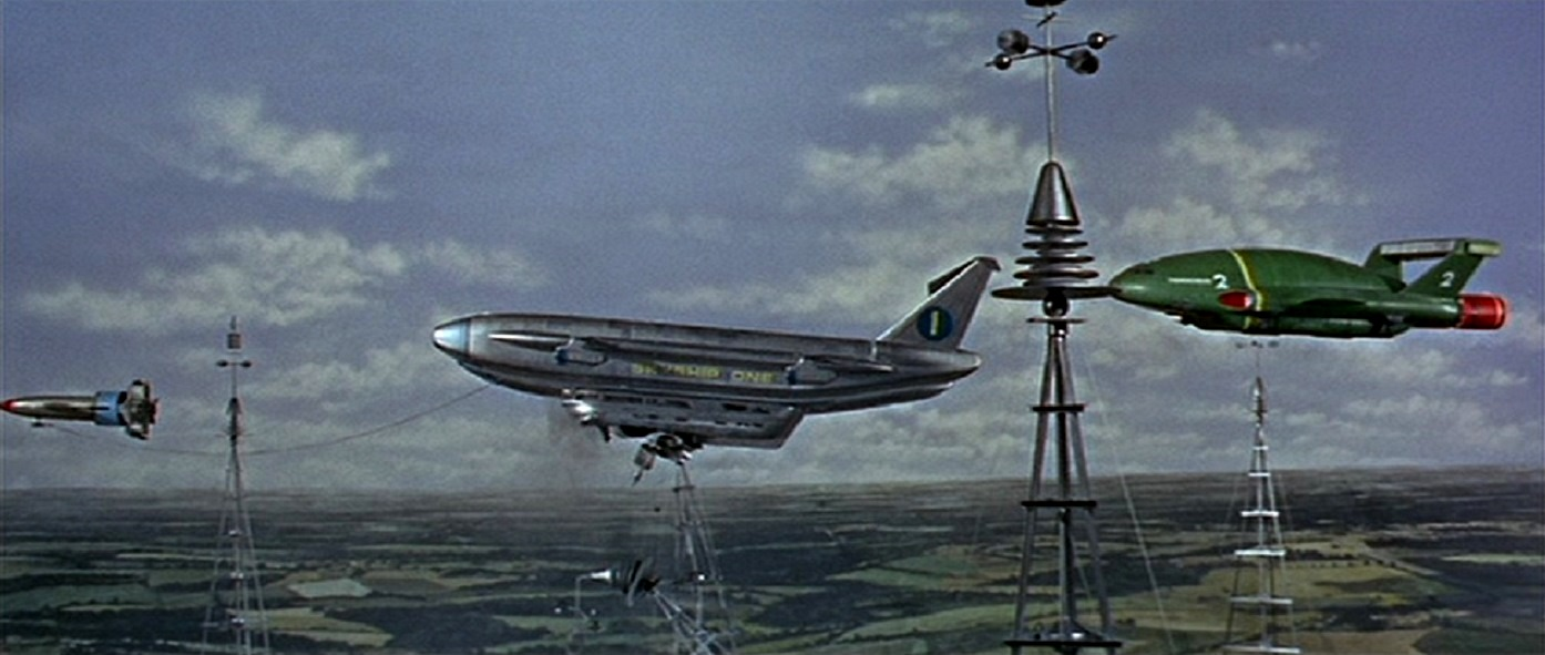 Rescue attempt of Skyship 1 impaled on a tower flanked by Thunderbird 1 and Thunderbird 2 in Thunderbird 6 (1968)